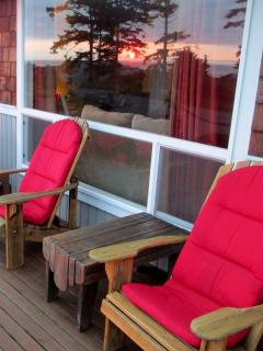 Enjoy the views from the comfort of the front deck; even the reflection is beautiful!