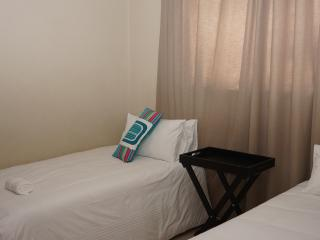 Bedrooms with linen and towels. The well lit and areated rooms are guranteed to make your stay great