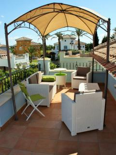 The furnished roof terrace, ideal for drinks and enjoying the last rays of sun each day