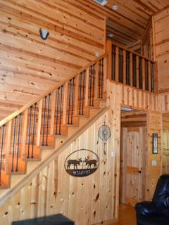 Our beautiful stairway featuring cedar and iron railings.