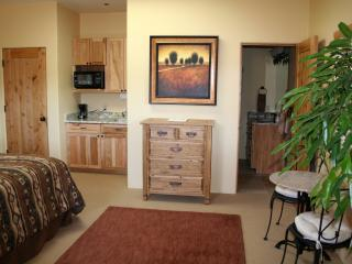 Cathedral Suite with kitchenette and granite bistro table
