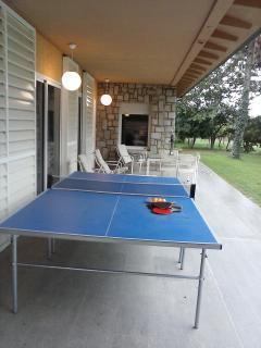 Ping pong game at the porch.