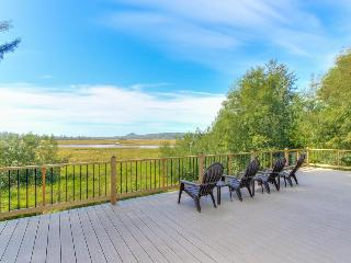 Enjoy fantastic Sandlake views from this waterfront home - dogs welcome!