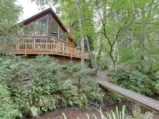 Expansive wooded home with a brook, hot tub, firepit, and shared pool