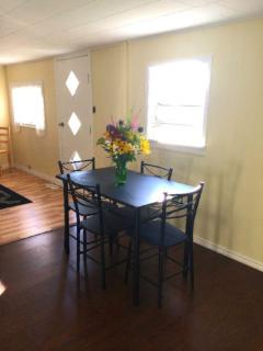 Open area with dining room and kitchen for healthy meals cooked in your cottage.