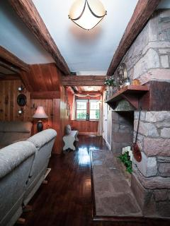 Huge original stone firplace, exposed beams and hard wood floors.
