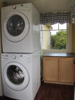New washer & dry in the bright laundry area.