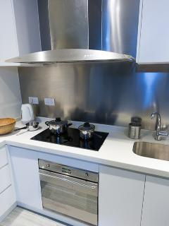 Kitchen cooker hood and hob