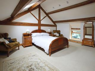 Airy double bedroom with vaulted ceilings