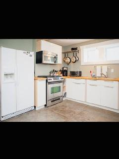 Kitchen; gas stove top & oven--fully stocked