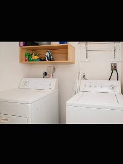 Laundry Room; iron, ironing board, detergent, drying rack