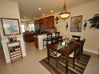 Dining room with breakfast bars on both sides of the kitchen Open to both living areas