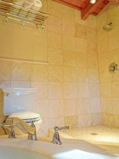 Herons Hideaway travertine bathroom. Separate jacuzzi and shower
