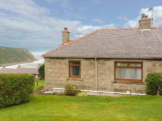 GAMRIE BRAE COTTAGE, woodburner, private garden, stunning views, in