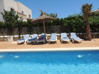 Pool with sun loungers