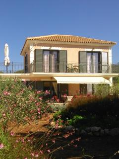 The villa is surrounded by a typical Greek herb garden and plenty of olive trees