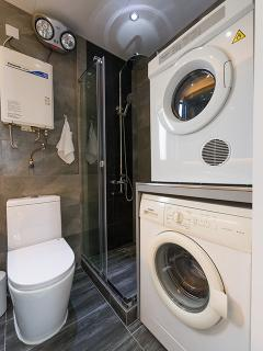Guest bathroom with washing machine and dryer
