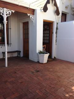 Paved courtyard and front door