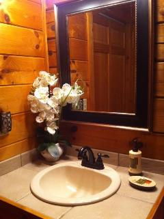 Our bathroom has washer/dryer and walk-in shower with rainforest showerhead.