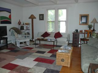 Large spacious Living/Dining room with sleeper sofa & fireplace