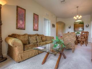 Take in a serene lake view from this comfortable and relaxing 3-bedroom condo, Orlando