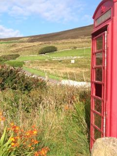 Turn off up to the Bakehouse at the red phone box, next to a stream. Nearly there.