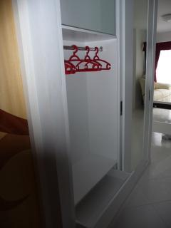 View on wand cupboard (left door and drawer opened). In the upper part you may store your luggage
