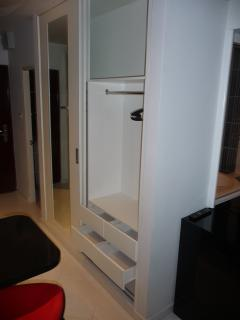 Wand cupboard (right door opened and drawers opened). In the upper part you may store your luggage.