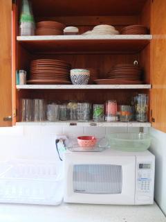 Toaster, microwave, blender, all utensils, pots, pans, knives, bakeware, etc. included.