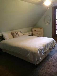 Master bedroom with queen size bed and walk out porch