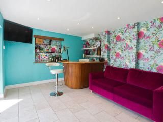 Bar and sofa bed in the garden / bar room; 5 bi fold doors open onto the garden and slipway