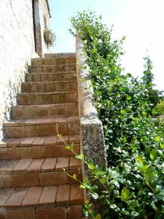 Outdoor staircase of the house that leads to upstairs bedrooms.
