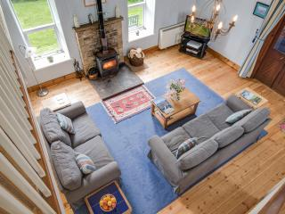 Aerial view of the light and airy living area from the mezzanine