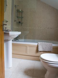 The bathroom has an overhead shower.