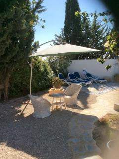sun canopy and wicker seating set