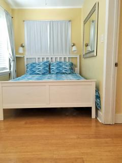 Queen bed w/room darkening shades walking room to left of bed small but manageable