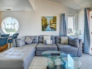 Stylish, dog-friendly combo duplex steps from the beach!