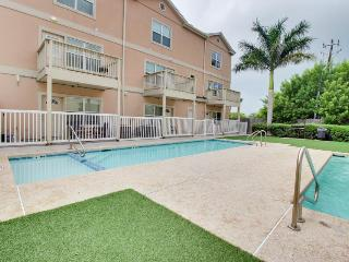 Walk your dog to the beach; shared pool and hot tub with this great home