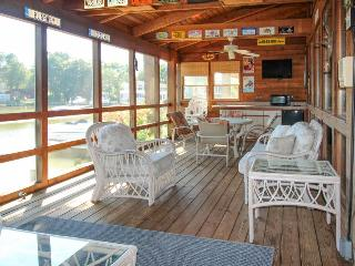 Colorful waterfront home on canal w/  dock & entertainment!
