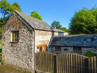 MILLER'S LODGE, romantic, character holiday cottage, with a garden in St Keyne