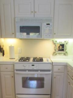 Kitchen Features Duel Fule Range, Microwave, Fridge With Ice and Water Through Door and Much More