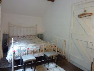 Bedroom one with double bed and antique bedspread