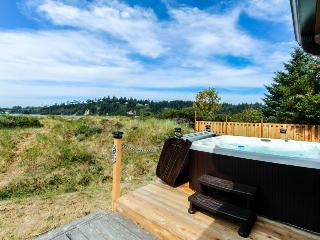 On Alsea Bay with bridge views, hot tub, dog friendly.