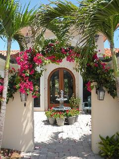 Front atrium with bougainvillea archway and water fountain