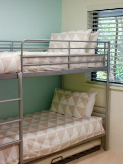 Single bunk beds plus a single trundle bed