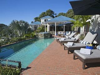 The pool and relaxing chaise lounges