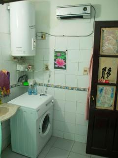Bathroom, washmachine and big hot water tank