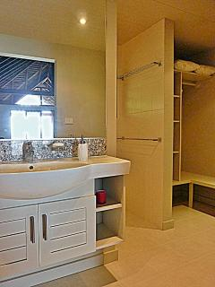 Bathroom, shower room and laundry with clothes hanging area.