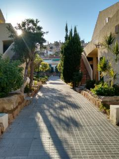 Walk way from gate to apartment.