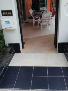 Way to the entrance door of the property, with inclined tiles to let wheelchair users in on terrace